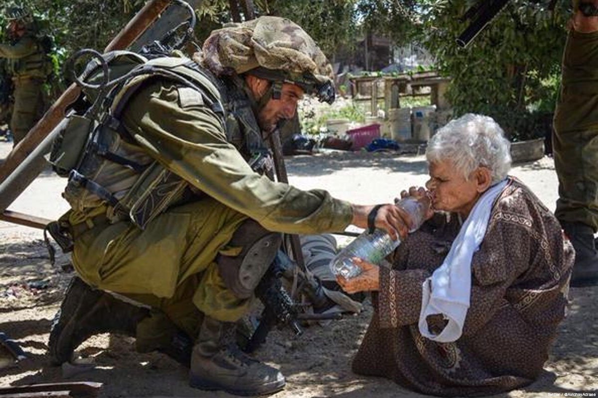 74-year-old Palestinian woman Ghalya Abu-Rida being given water by Israeli troops, minutes before she was executed